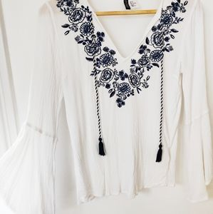 Boho-chic bell sleeve embroidered top